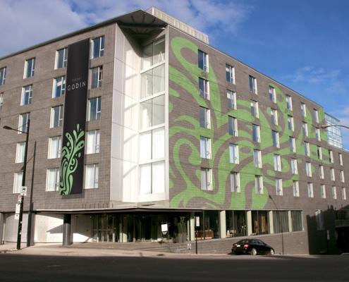 Impression et pose de kakémono, calicot ou adhésif mural sur façade d'immeuble.